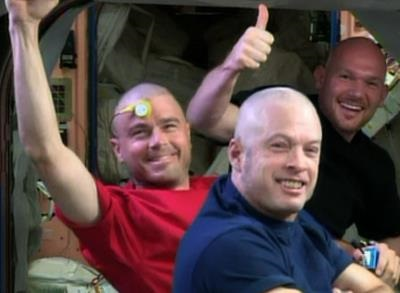 News video: Raw: NASA Astronauts Shave Head for USA Loss